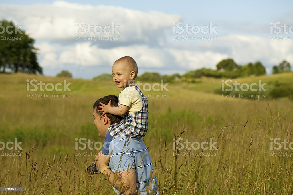 happy father and child on a beautiful field royalty-free stock photo