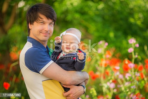 480122543 istock photo Happy father and child playing together on the poppy meadow. 1214687380