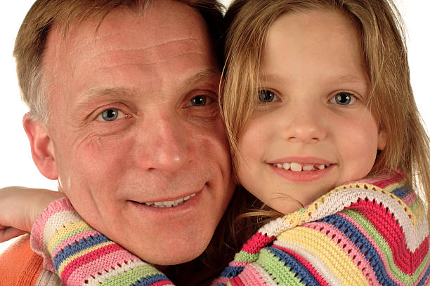 happy father and daughter closeup happy father and daughter closeup little girl kissing dad on cheek stock pictures, royalty-free photos & images