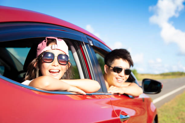 Happy father and daughter enjoy road trip stock photo