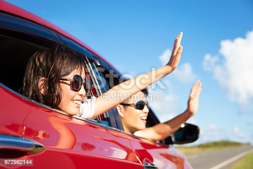 972962180 istock photo Happy father and daughter enjoy road trip 972962144