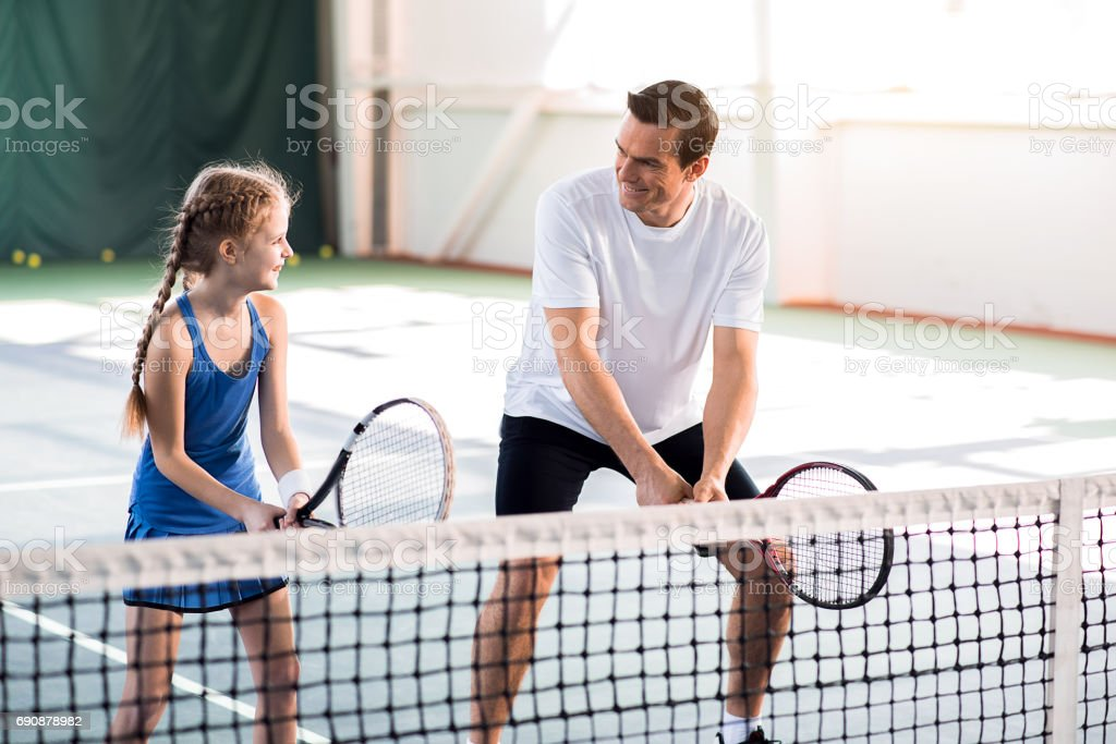 Happy father and daughter enjoying playtime stock photo