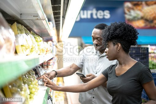 1184048369 istock photo Happy father and daughter in supermarket 1184044651