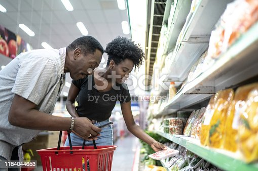 1184048369 istock photo Happy father and daughter in supermarket 1184044653