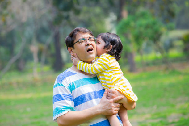 Happy father and daughter stock photo Father, daughter , Child, Picking Up, girls little girl kissing dad on cheek stock pictures, royalty-free photos & images