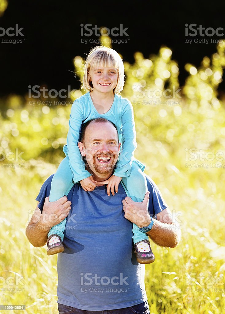Happy father and little daughter having fun in the sun stock photo