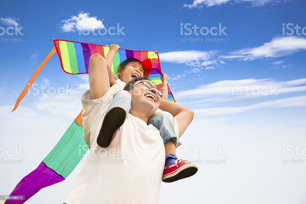 happy father and little girl with colorful kite royalty-free stock photo