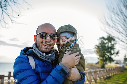 505122600 istock photo Happy father and son at sunset 1222067808
