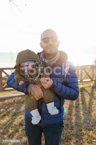 505122600 istock photo Happy father and son at sunset 1222068285