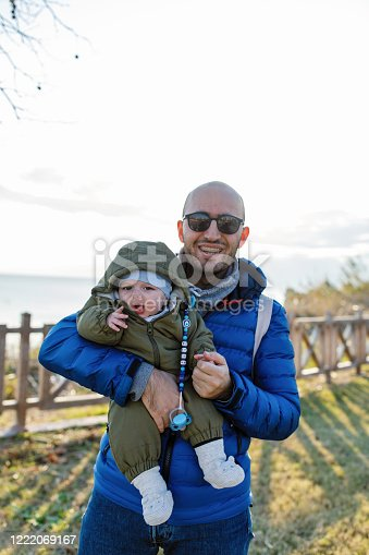 505122600 istock photo Happy father and son at sunset 1222069167