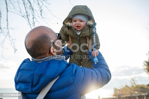 505122600 istock photo Happy father and son at sunset 1222069483