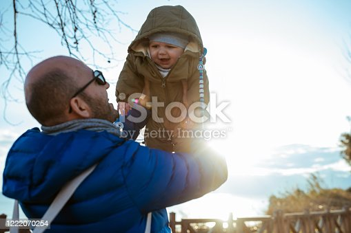 505122600 istock photo Happy father and son at sunset 1222070254