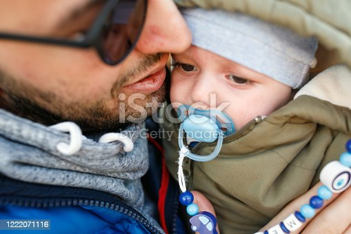 505122600 istock photo Happy father and son at sunset 1222071116