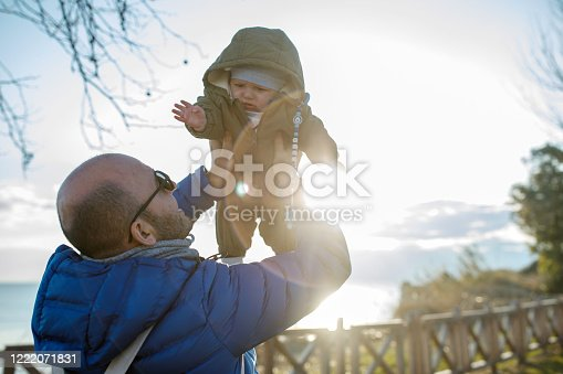505122600 istock photo Happy father and son at sunset 1222071831