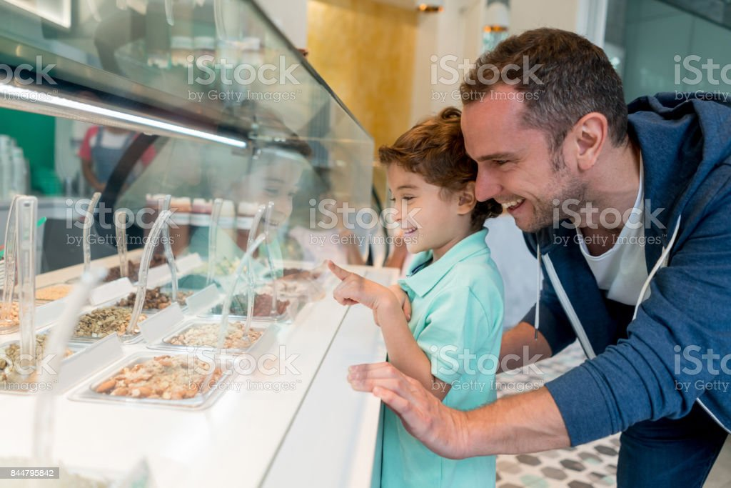 Happy father and son at the ice cream shop stock photo