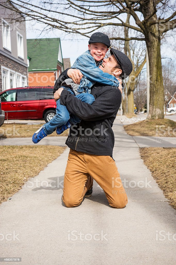 Happy father and son having a hug outside royalty-free stock photo