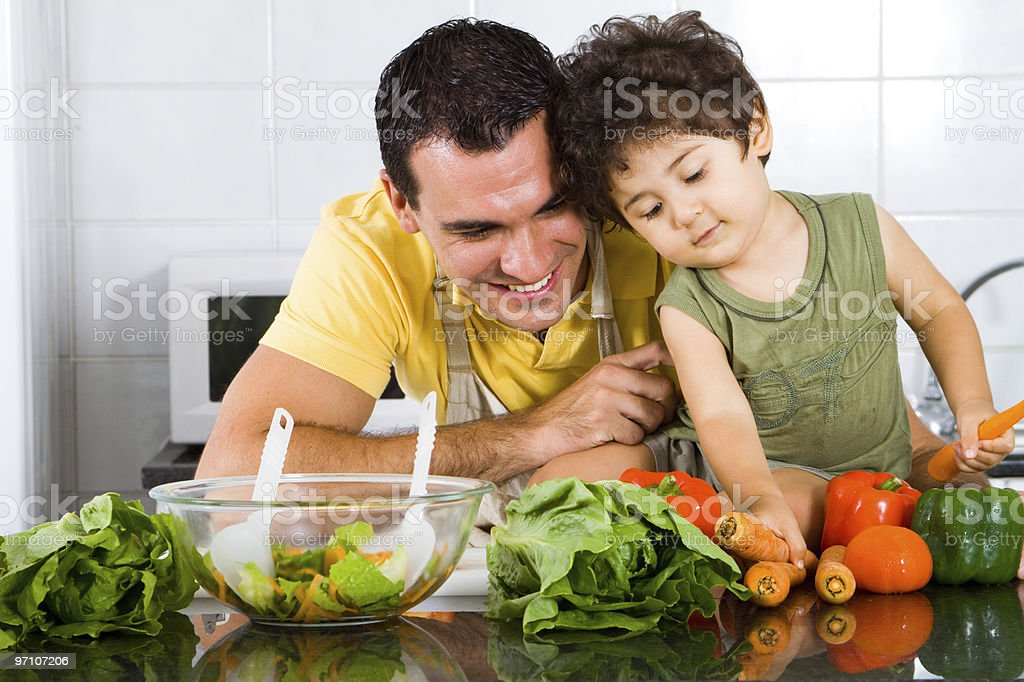 happy father and son in kitchen royalty-free stock photo