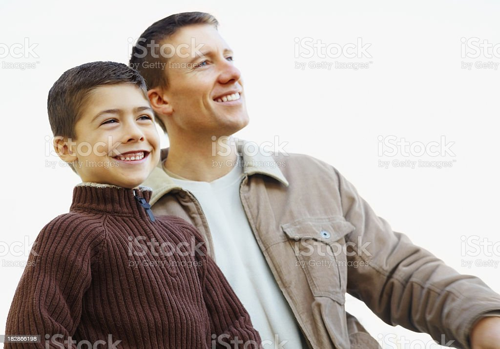 Happy father and son looking away against white background royalty-free stock photo