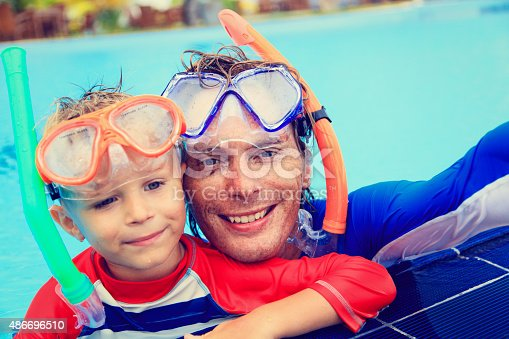 596350174 istock photo happy father and son snorkeling making selife 486696510