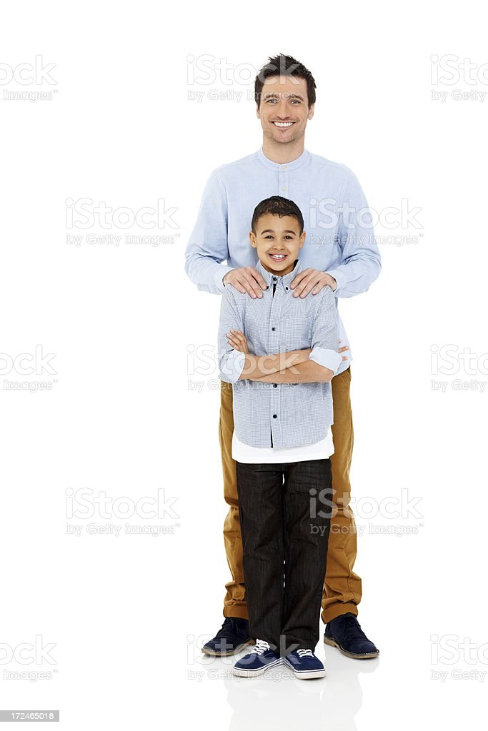 c47de4387 Happy father and son standing together on white royalty-free stock photo