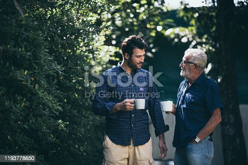 Happy Father and son with coffee cup