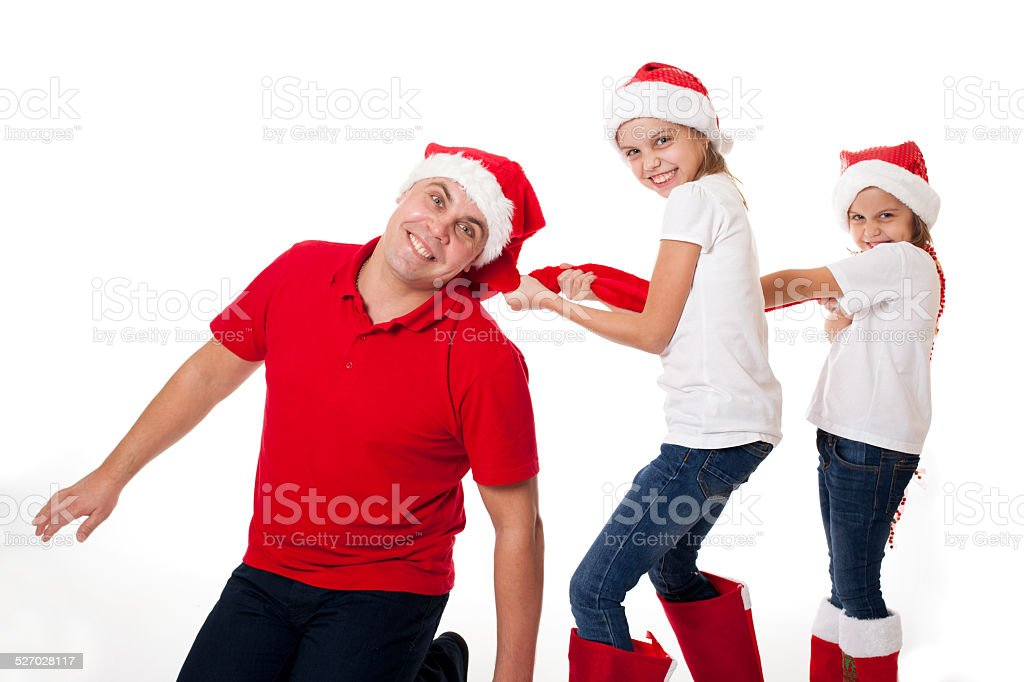 3b2079ccf Happy Father And Two Daughters In Santas Hats Laughing Stock Photo ...