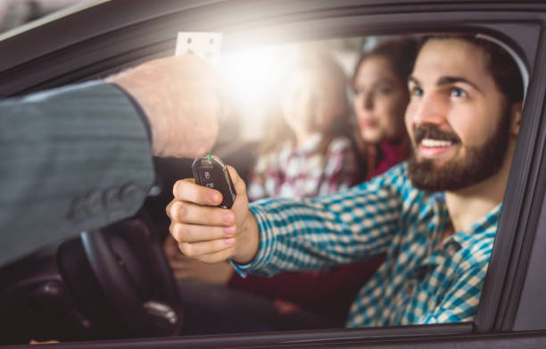Happy father buying a new car. stock photo