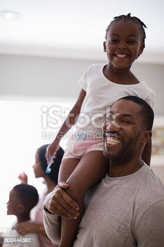 800444456 istock photo Happy father carrying carrying daughter in bathroom at home 800444362