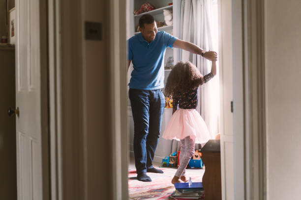 happy father dancing with daughter in bedroom - daughter stock photos and pictures