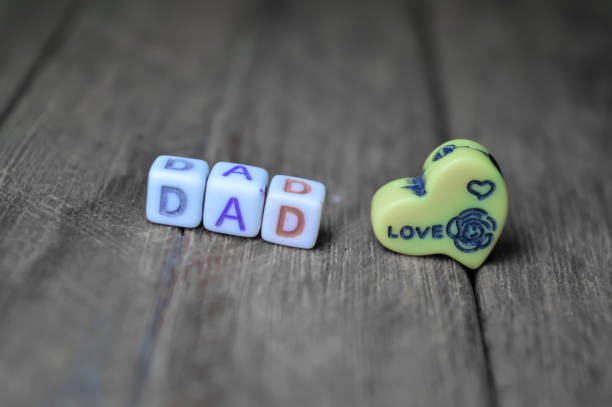 happy father day, writing a dad on wooden table - love word foto e immagini stock