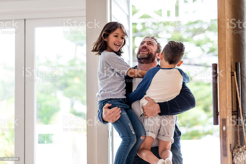 Happy father greeting his children stock photo