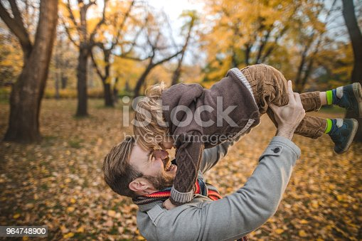 Happy Father Having Fun With His Little Boy In Autumn Day Stock Photo & More Pictures of Adult