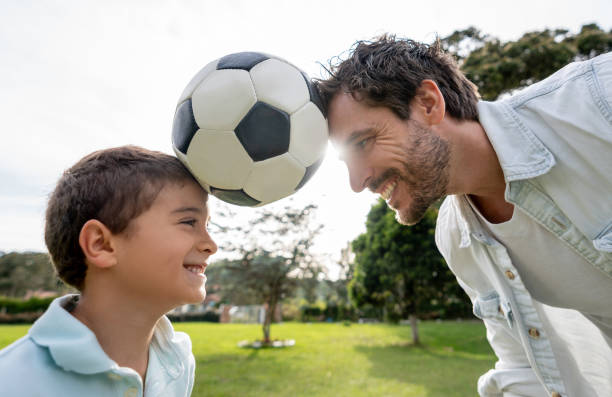 Happy father playing football with his son at the park picture id1152470887?b=1&k=6&m=1152470887&s=612x612&w=0&h=tr8rc6qc getded4 lyfdup9vvttsjovb3 l5h wqbm=