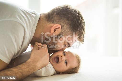 istock Happy father playing with his daughter 641778230