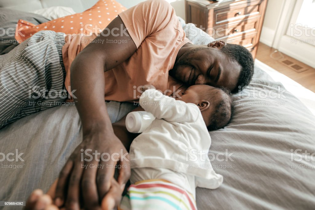 Happy father playing with toddler son stock photo