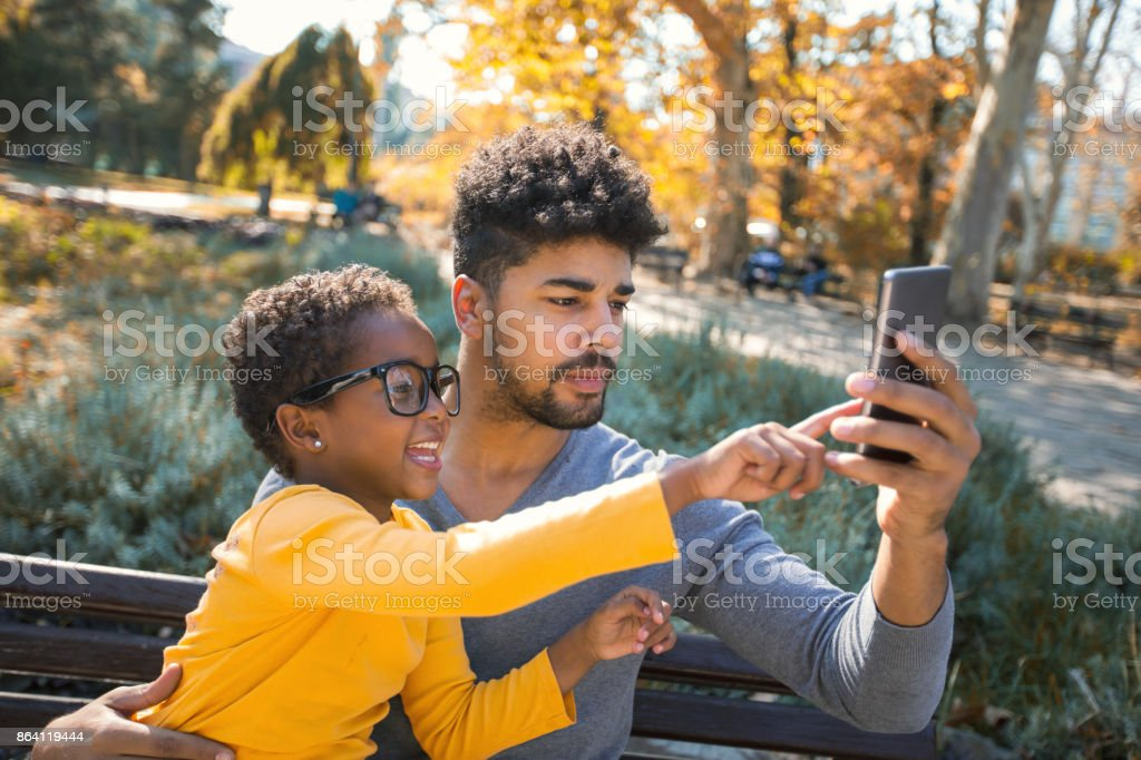 Happy father spending time with their daughter royalty-free stock photo