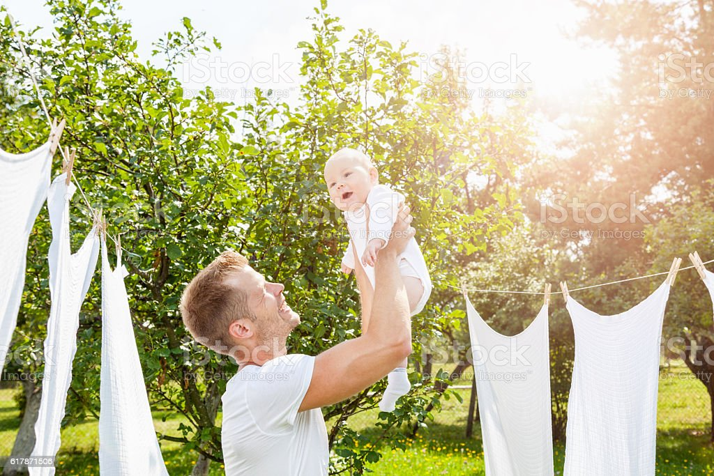 Happy father with a baby outdoors stock photo