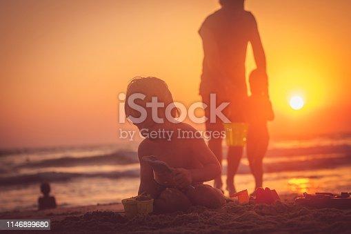 Family having fun on the beach  in summer
