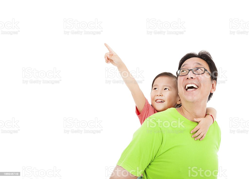 Happy father with daughter looking and pointing royalty-free stock photo