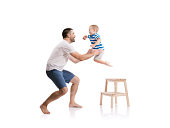 Happy young father with his son. Studio shot on white background.