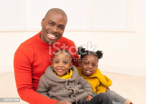 172407626 istock photo Happy Father with Two Children 155287339