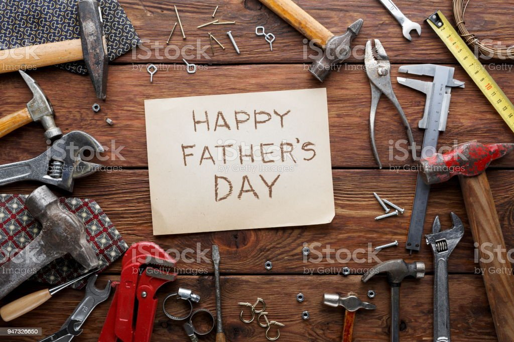Happy Fathers Day background, card on rustic wood with repair tools...