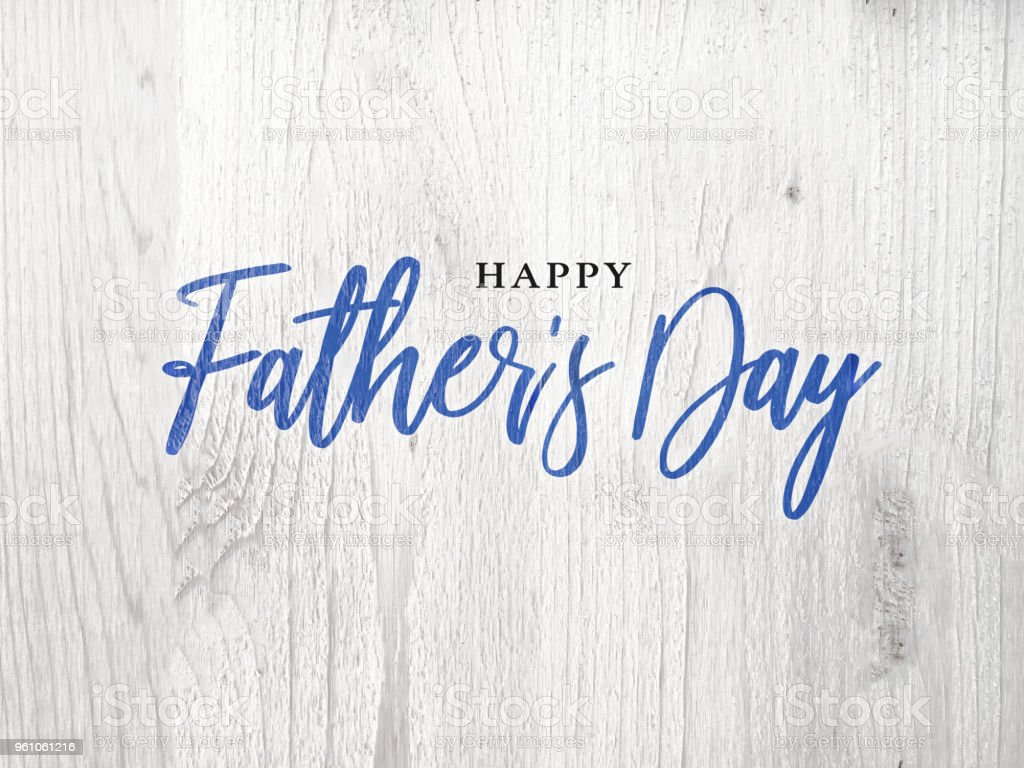 Happy Father's Day Blue Calligraphy Script Over White Wood stock photo