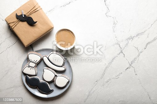 istock Happy father's day concept. Plate with delicious cookies and a gift 1223887520