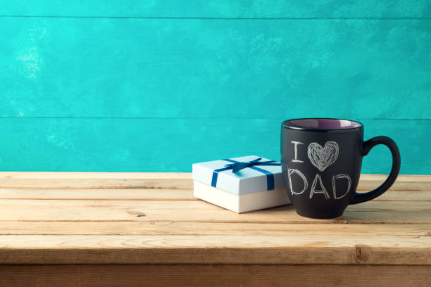 happy father's day concept with coffee mug and gift box over wooden background - fathers day stock pictures, royalty-free photos & images