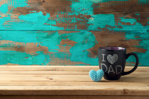 Happy Father's day concept with coffee mug and gift box over wooden background stock photo