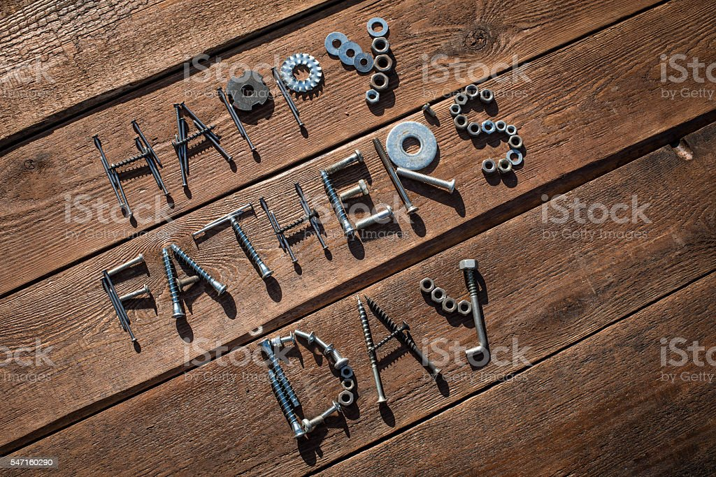 Happy Father's Day. Greeting made of nuts and bolts stock photo