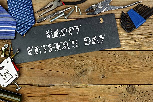 Happy Father's Day greeting on slate with border of tools stock photo