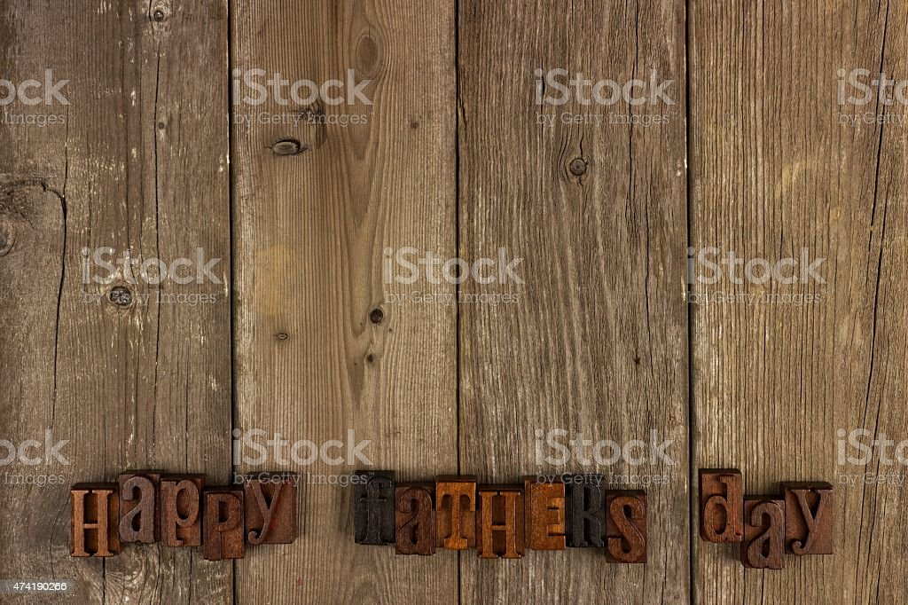 Happy Fathers Day letters on rustic wood stock photo