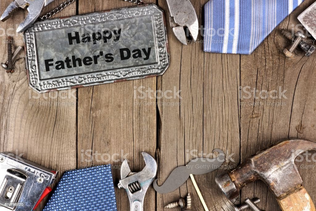 Happy Fathers Day metal sign with double border on wood stock photo